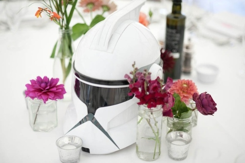 a Stromtrooper mask and bold blooms and candles compose a bold and very cool Star Wars themed wedding centerpiece