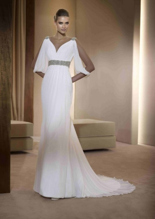 a Grecian-style wedding dress with embellished shoulders and a sash and a train is inspired by some looks from Star Wars