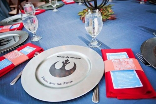 a silver charger with a Star Wars print is a lovely and cool idea for a modern star Wars themed wedding