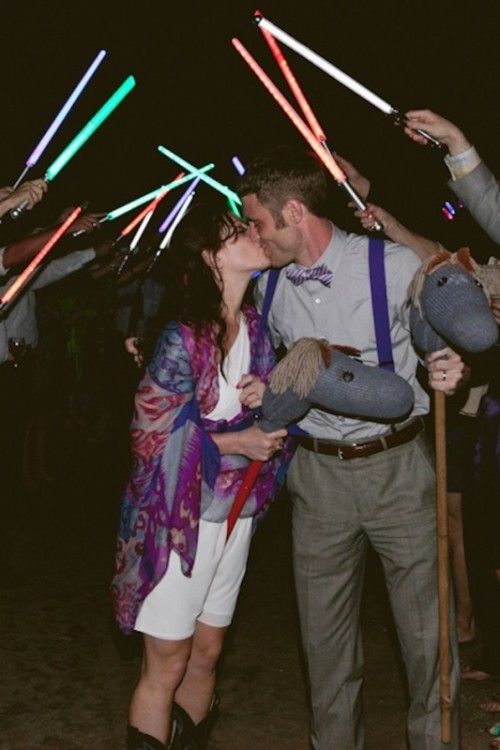 Star Wars lightsabers showing off your wedding exit are a fun and cool idea for a Star Wars wedding