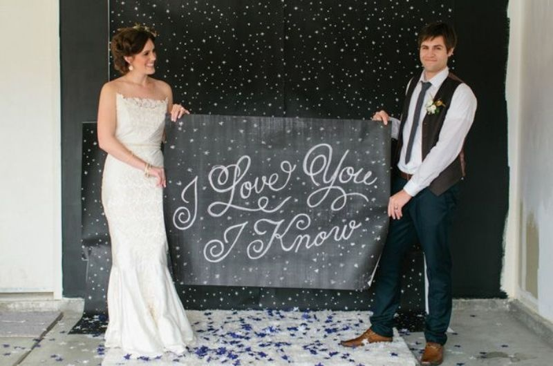 a chalkboard sign with a quote from Star Wars is a very cool and cute idea for a Star Wars wedding