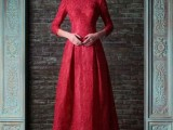 a red lace A-line wedding dress with a high neckline, long sleeves and a pleated skirt for a Gothic bride