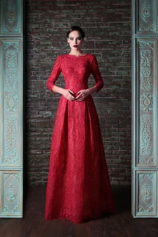 a red lace A line wedding dress with a high neckline, long sleeves and a pleated skirt for a Gothic bride