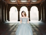 a dove grey off the shoulder wedding ballgown with a layered bodice and skirt is a glam and romantic option