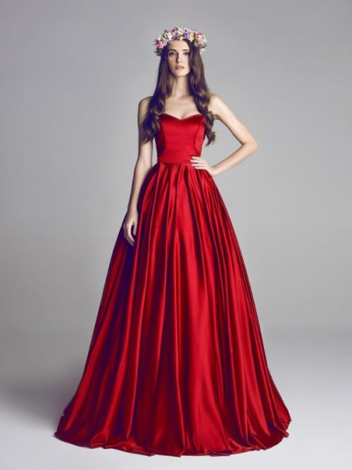 a deep red strapless wedding ballgown with a sleek bodice and a pleated full skirt for a bold statement with color
