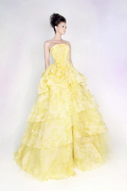 a yellow and white strapless wedding ballgown with a ruffled skirt is a bold statement you may make with both color and design