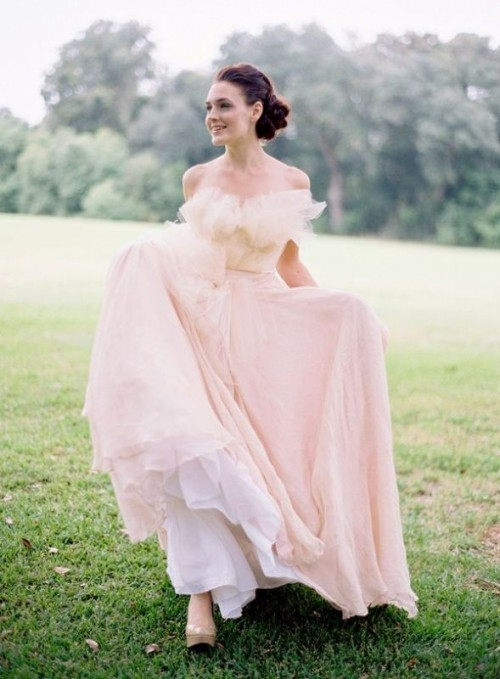a tender light pink off the shoulder wedding dress with a ruffle neckline and a layered skirt plus a train is a very delicate and chic option