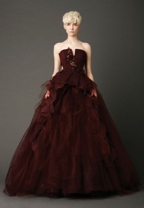 a statement chocolate brown wedding ballgown with an embellished bodice and a layered skirt with a train is a cool idea for a fall wedding