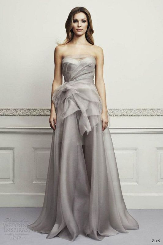a silver strapless A line wedding dress with a draped bodice and a fabric bloom on the side plus a small train is very elegant