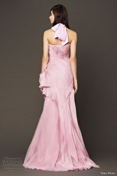 a pink wedding dress with a draped bodice and skirt, a large bow on the neck for a soft touch of color