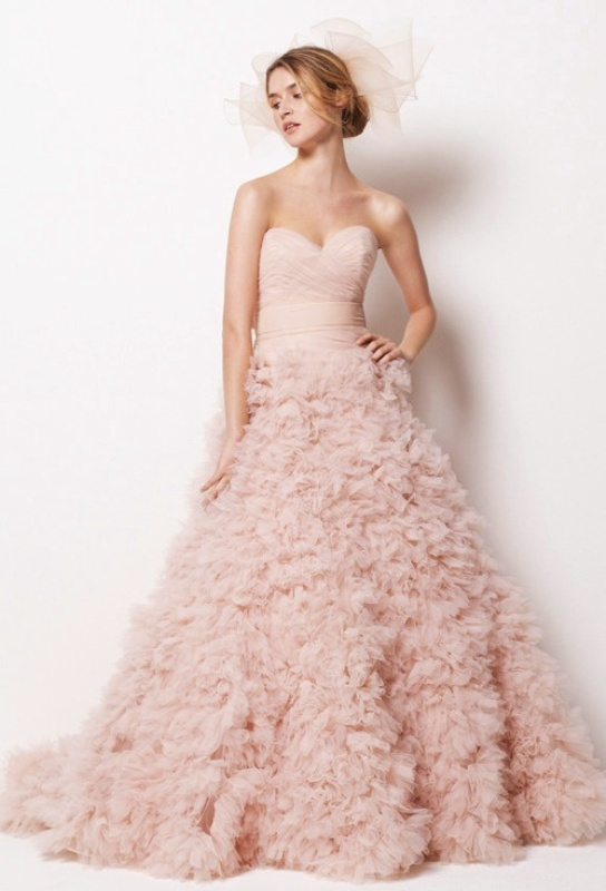 a blush strapless wedding ballgown with a wrapped bodice and a large ruffle skirt with a train plus a veil is wow