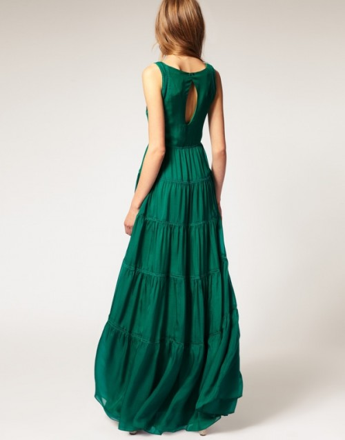 an emerald high neckline A-line wedding dress with a keyhole back and a tiered skirt for a boho bride