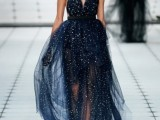 a midnight blue a-line wedding dress with thick black straps and a layered skirt is fully embellished and very bold, great for a celestial bride