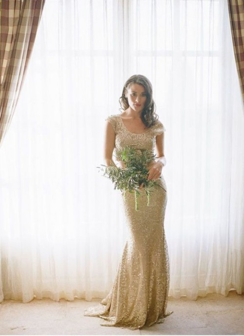 a shiny gold sequin sheath wedding dress wiht a scoop neckline, cap sleeves and a small train is glam and cool