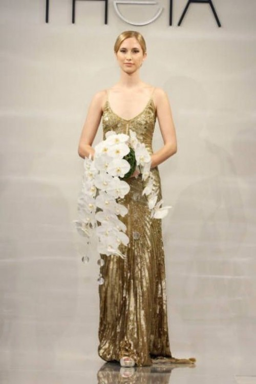 a dark gold spaghetti strap A-line wedding dress with patterns and a train is a very romantic and refined idea