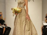 a fabulous shiny gold A-line wedding dress with a sleeveless bodice, an open back and a full skirt plus a train