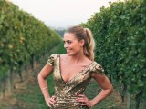 a dark gold sequin sheath wedding dress with cap sleeves and a deep V-neckline and a draped bodice is pure elegance and glam
