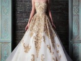 a strapless A-line wedding dress in white with gold embroidery and appliques is an exquisite dress for a formal wedding