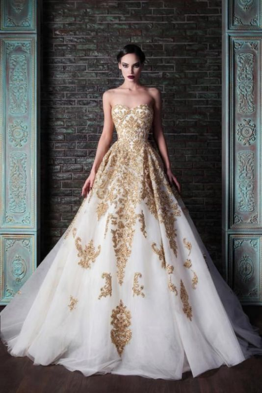 a strapless A line wedding dress in white with gold embroidery and appliques is an exquisite dress for a formal wedding