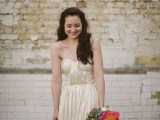 a shiny gold strapless A-line wedding dress with a draped bodice and a pleated skirt is a chic and shiny glam option