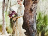a stunning gold sequin sheath wedding dress with a high neckline, long sleeves and a sheer tan tail impresses