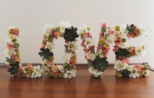 LOVE letters made of faux blooms and succulents that won't wither even if the weather is hot