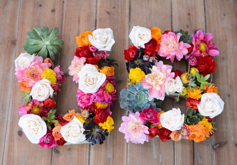floral monograms done with various bright blooms and some succulents will fit a tropical or just a bright wedding