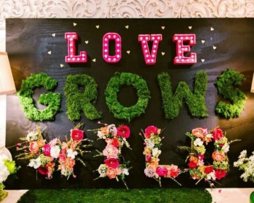 various letters made of marquee lights, moss and blooms will enliven your reception space and make it bolder