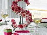 a monogram covered with pink roses can be a nice part of a wedding centerpiece