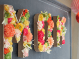 letters filled with bright blooms will make a bold and cool decor statement like here