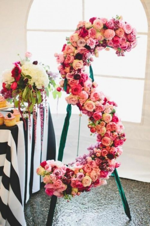 a large monogram done with pink, fuchsia and blush blooms is a chic decoration for a wedding