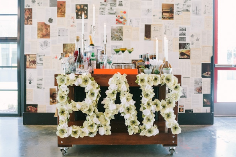 BAR letters done with white blooms are amazing for decorating your wedding venue