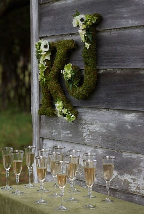 moss letters decorated with white ranunculus are a cool rustic decoration for any wedding