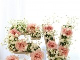monograms decorated with baby's breath and blush roses are a very cute and tender decoration