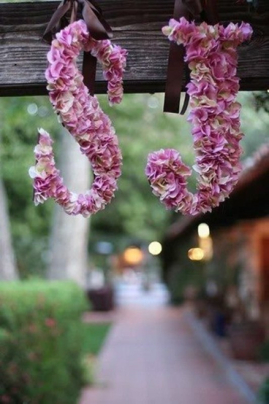 monograms done with pink blooms are very cute and very romantic decorations