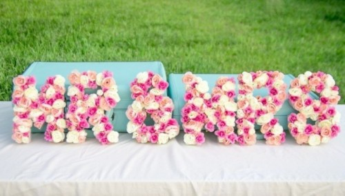 Mr and MRs letters done with pink and white blooms are very bold and cool ones