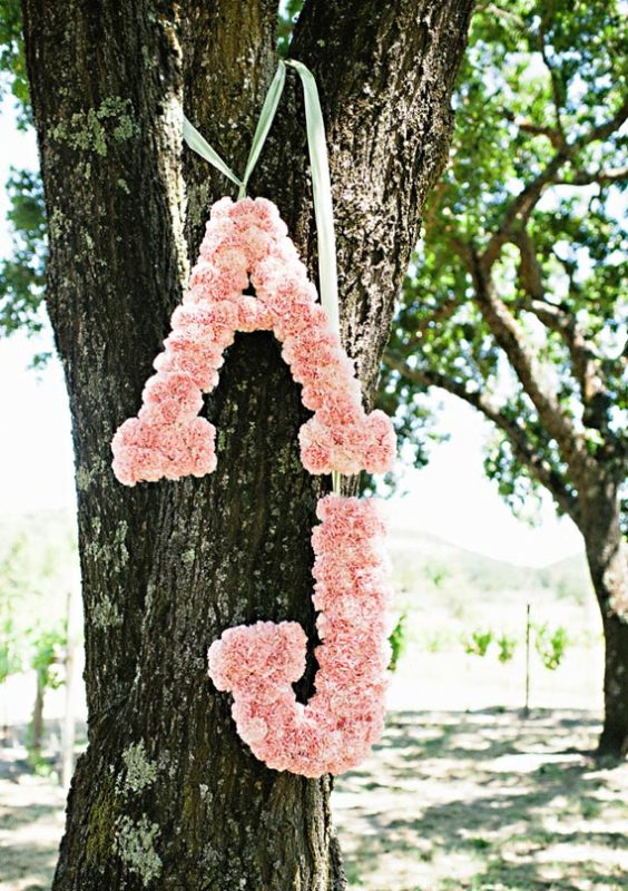pretty monograms done with pink roses to stick to the color scheme and add cuteness to the decor
