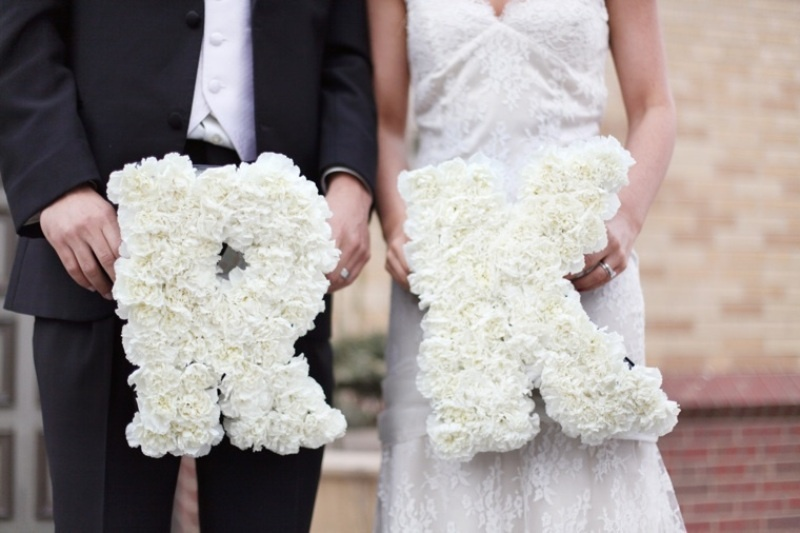 monograms done with white roses are very cute and classic   such a color is perfect for a black and white color scheme