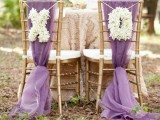 XO letters made of white blooms can be hung on your wedding chairs to mark them right