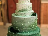 a jaw-dropping ombre green wedding cake with glitter dust, edible beads and dark foliage for a St. Patrick's wedding