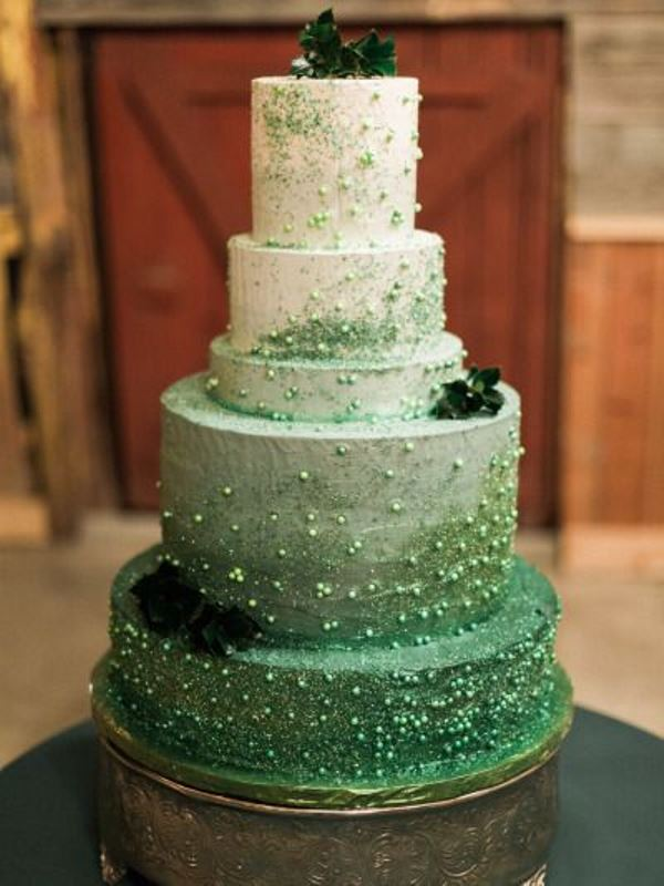 a jaw dropping ombre green wedding cake with glitter dust, edible beads and dark foliage for a St. Patrick's wedding