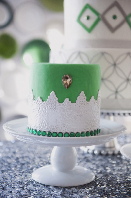 a vintage green wedding cake with sugar lace detailing, a copper crystal and emerald rhinestones for a vintage summer wedding
