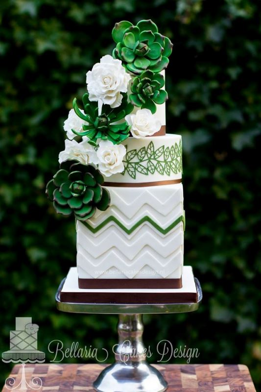 a bold square and round wedding cake with chevron patterns, botanical ones, white natural and green sugar blooms