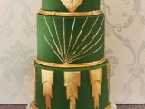 an art deco green and gold wedding cake with geometric detailing is a chic and cool idea for a 20s wedding