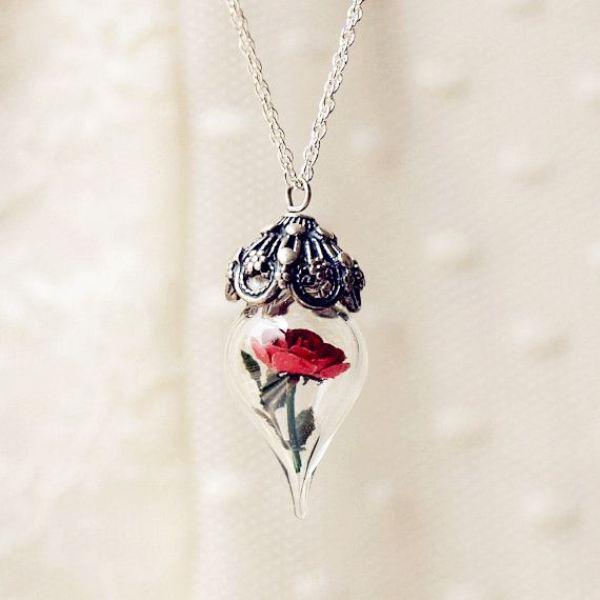 a unique vintage inspired wedding necklace of a red rose in a jar and some silver and rhinestone cover is a beautiful accessory for a bride or bridesmaids