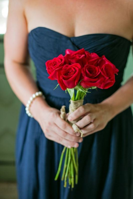 a classic red rose wedding bouquet is a nice idea for both a bride or a bridesmaid, it can be carried for any type of a Valentine's Day wedding