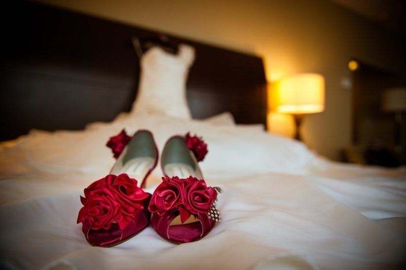 red peep toe shoes topped with fabric red roses will easily fit a vintage inspired bridal look at her Valentine's Day wedding