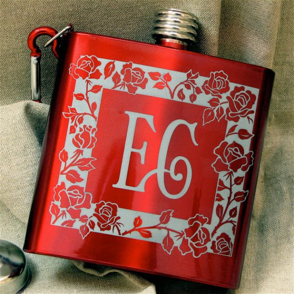 a red flask with a rose pattern is a lovely favor idea   for a groom or a bride, for bridesmaids or groomsmen, lovely for a Valentine's Day wedding