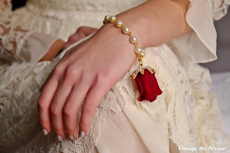 a creative pearl and faux red rose bracelet is a beautiful and romantic accessory for a Valentine's Day vintage bride