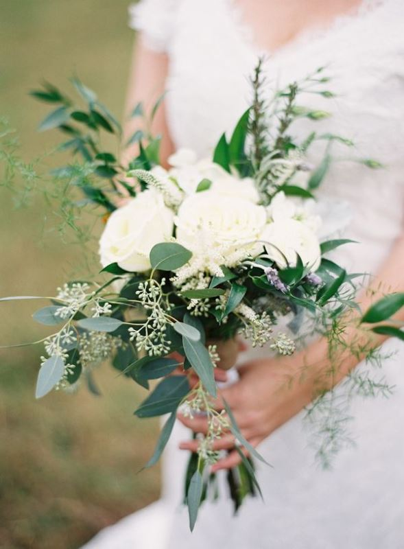 a beautiful organic wedding bouquet of greenery and white blooms is a timeless bridal idea